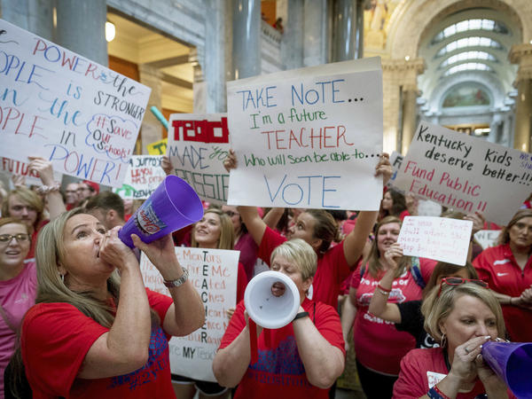 Teachers from across Kentucky gather inside the state Capitol to rally for increased funding for education on Friday.