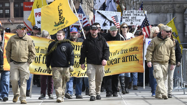 Activists with the National Constitutional Coalition of Patriotic Americans march in Albany, N.Y. The organization spread the word about coordinated gun rights rallies in state capitols across the U.S.