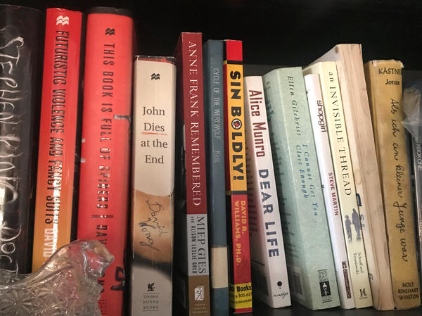 "Cindy Duell keeps a shelf of ""wish books"" that she hopes to be able to read one day."