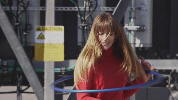 """A still from Media Jeweler's """"Hula Hoop"""" video."""