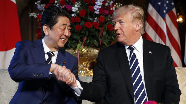 President Trump and Japanese Prime Minister Shinzo Abe shake hands during their meeting at Trump's private Mar-a-Lago club in Palm Beach, Fla., on Tuesday.