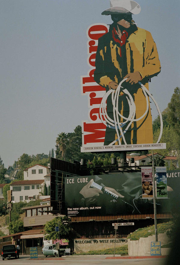 A billboard advertising Marlboro cigarettes overlooks Sunset Boulevard in in the Beverly Hills section of Los Angeles in 1994.