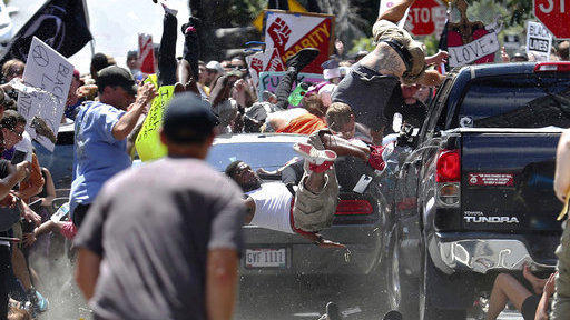 People fly into the air as a vehicle drives into a group of protesters demonstrating against white nationalists in Charlottesville, Va. on Aug. 12, 2017. Kelly won a Pulitzer Prize for the image.