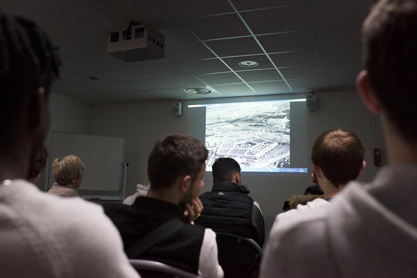 Students watch a conspiracy video created by Huchon at Lycee Baggio High School in Lille, France. The video is part of Huchon's group Conspi Hunter's curriculum on identifying fake news.