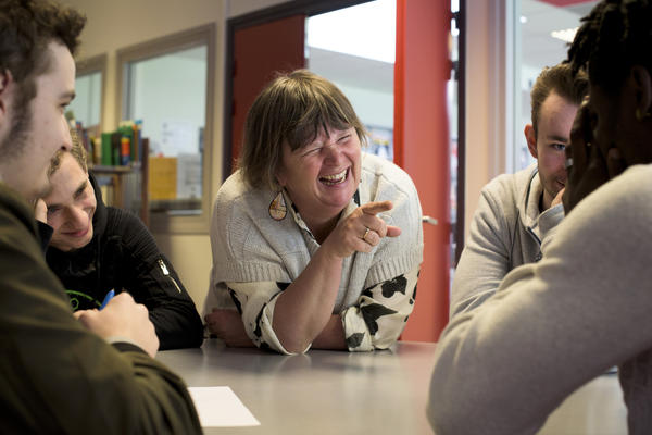 French and history/geography teacher Corinne O'Miel laughs with her students while helping them to create a conspiracy theory involving Kim Kardashian, bus drivers and Wi-Fi.