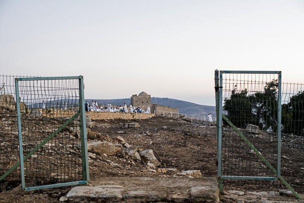Samaritans pray among ruins at the top of Mount Gerizim in the West Bank.