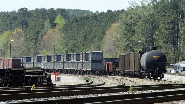 "Containers loaded with tons of sewage sludge sit simmering in the sun last week in Parrish, Ala. More than two months after the ""poop train"" rolled in from New York City, Parrish Mayor Heather Hall says the material is leaving town."