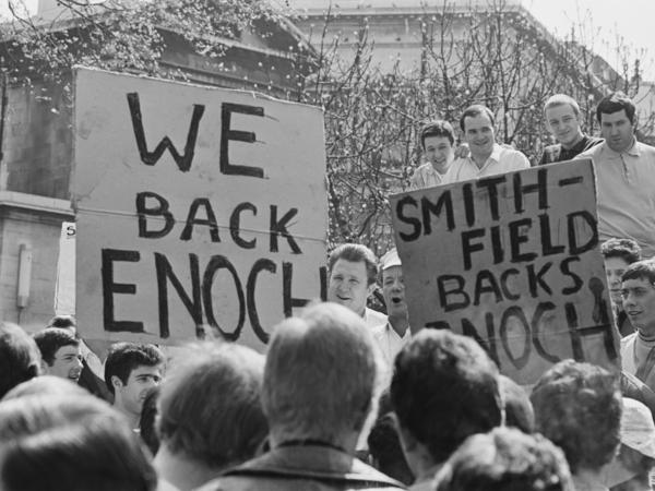 "Smithfield meat porters march to Parliament to hand in a petition backing British politician Enoch Powell, on April 25, 1968, five days after Powell's ""Rivers of Blood"" speech."