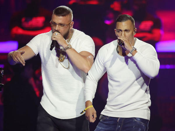Rappers Farid Bang and Kollegah, performing on stage during the Echo Awards show in Berlin on April 12.