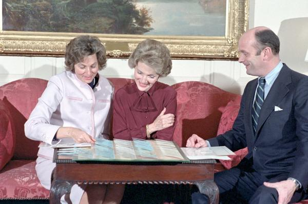 First lady Nancy Reagan reviews plans for the administration's first state dinner in February 1981.