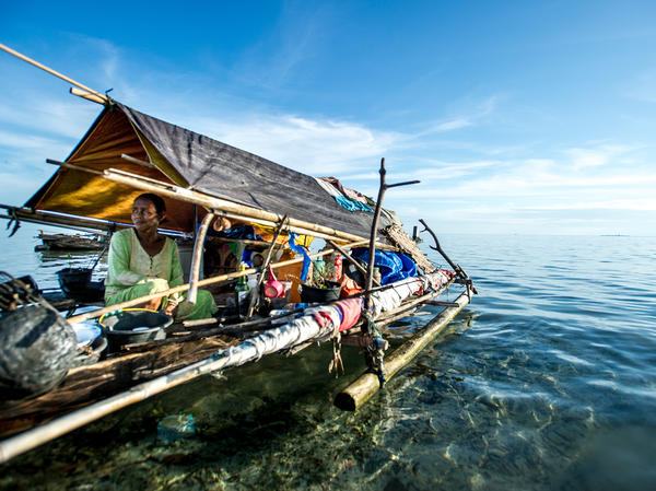 Ibu Diana Botutihe has lived her entire life at sea, visiting land only intermittently to trade fish for rice, water and other staples. Here she is pictured on her boat in Sulawesi, Indonesia.