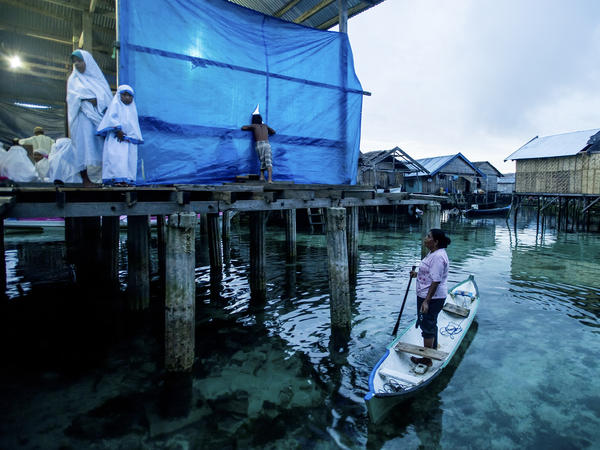 Many of the Bajau now live in houses perched on stilts, but they hold a deep reverence for the ocean and the spirits that they believe inhabit the waters.