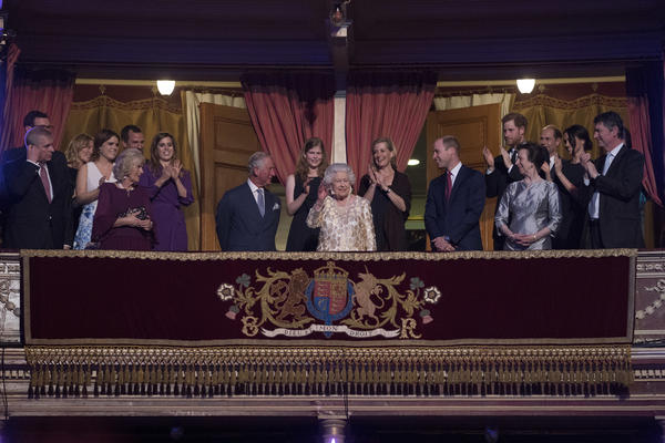 Flanked by members of the royal family, the queen takes her seat at the Royal Albert Hall in London to attend a charity concert to mark her birthday.