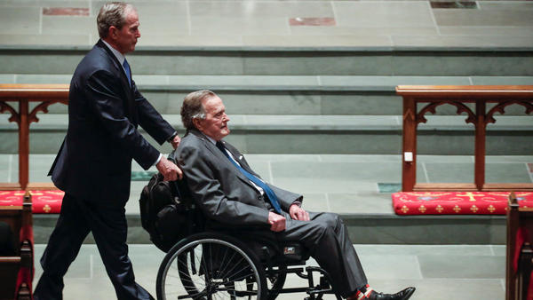 Former President George W. Bush wheels his father, former President George H.W. Bush, into St. Martin's Episcopal Church on Saturday for former first lady Barbara Bush's funeral, in Houston.