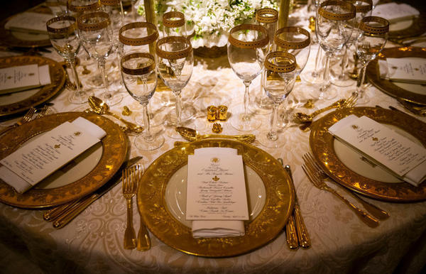 Dinner china is set for the first state visit of the Trump administration, in the State Dining Room of the White House on Monday.