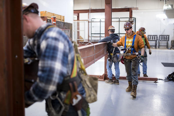 Garret Morgan (center) is training as an ironworker near Seattle and already has a job that pays him $50,000 a year.