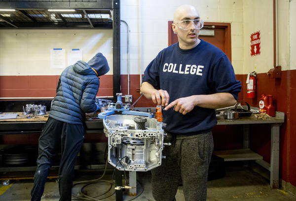 Matthew Dickinson, 21, asks a classmate for help as they rebuild an automatic transmission in an auto repair technician program classes at the Lake Washington Institute of Technology.