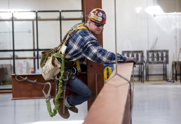 Taylor Fawcett, 23, moves a column during a connector mockup drill at the Iron Workers Local Union #86 Administrative Offices in Tukwila, Wash.