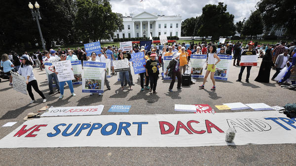 Supporters of Deferred Action for Childhood Arrivals program (DACA), demonstrate on Pennsylvania Avenue in front of the White House in Washington, D.C., on Sept. 3, 2017. A federal judge on Tuesday became the third judge to rule against the administration's plans to end DACA after federal judges in California and New York handed down similar decisions.