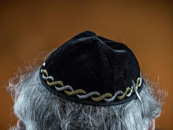 "A Jewish man wears a yarmulke, also called a kippa, during a meeting on ""the German and French perspectives on immigration, integration and identity"" organized by the American Jewish Committee this week in Berlin."
