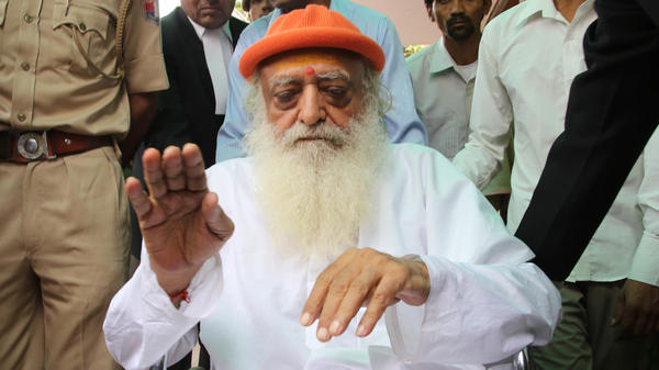 Spiritual leader Asaram Bapu has been sentenced to life in prison over a sexual assault case involving a 16-year-old girl. He's seen here arriving at the district session court for hearing in 2016.