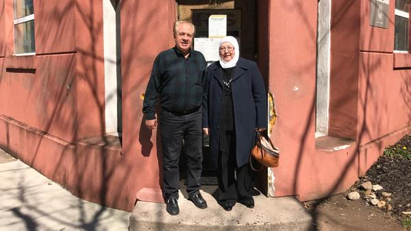 Haitham Dalati, left, and his wife Shiyam Daghestani, outside the offices of Integrated Refugee & Immigrant Services in New Haven, Conn.