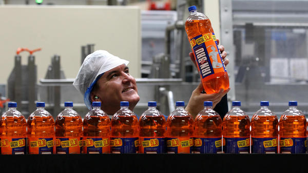 "Irn Bru is known as Scotland's ""other national drink."" But the beloved bright orange soft drink is a sugar bomb, so its makers have reformulated it to comply with a new U.K. sugar tax."