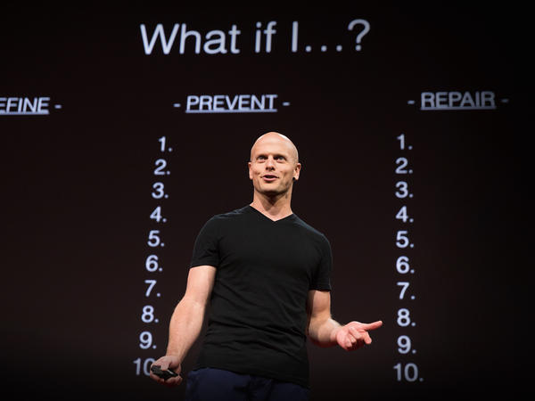 Tim Ferriss speaks on the TED stage.