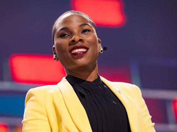 Luvvie Ajayi speaks on the TED stage.