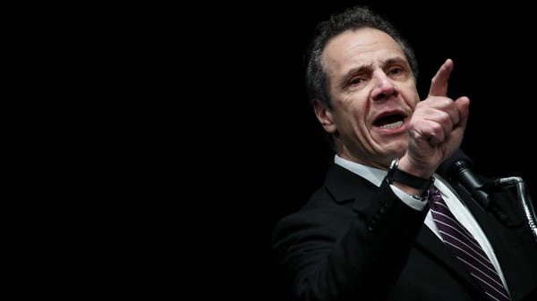 New York Gov. Andrew Cuomo speaks at a health care union rally at the Theater at Madison Square Garden on Feb. 21. Cuomo is threatening to sue federal immigration authorities and accused them of violating the law.