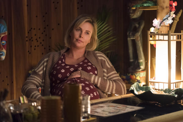 "Theron says she loved the script for <em>Tully </em>because it felt like an ""honest conversation"" about parenting."