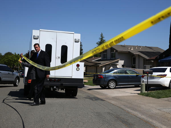 Law enforcement officials leave DeAngelo's Citrus Heights, Calif., home on Tuesday. Investigators say they zeroed in on DeAngelo using DNA that matched with a relative of his on a genealogical website.