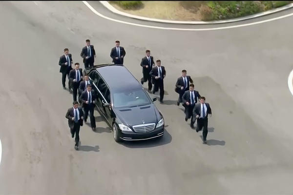 Security personnel accompany a vehicle transporting North Korean leader Kim Jong Un at the inter-Korean summit.