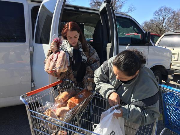 Amy Truckowski (left) and Sandra Viloria are U.S. Army veterans. They carpooled to the Leavenworth Mission Food Pantry in March to pick up groceries.