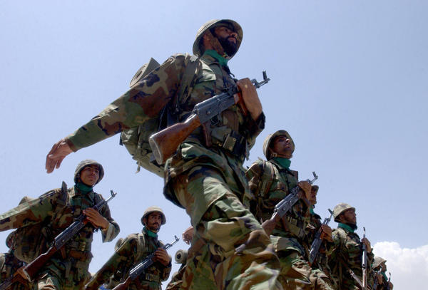 Afghan National Army soldiers march at a ceremony marking the end of a formal disarmament and reintegration program in Kabul on July 7, 2005. Afghanistan said it had completed the first stage of the U.N.-backed disarmament program aimed at collecting weapons including tanks and cannons from tens of thousands of former militiamen.