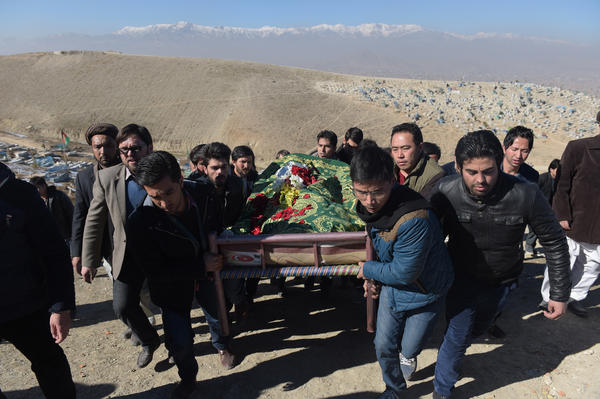 Afghan mourners carry the coffin of Saeed Jawad Hossini, 29, one of seven killed in a suicide attack on a minibus carrying employees of Afghanistan's TOLO TV channel in Kabul on Jan. 21, 2016.