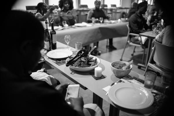 People participate in the Blackness in America dinner series in Austin.