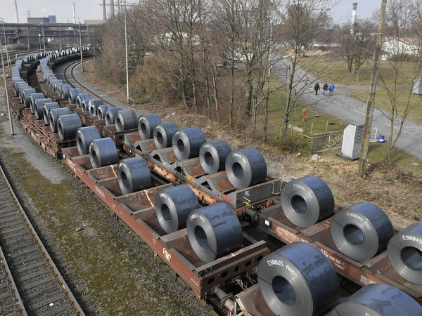 Steel coils sit on wagons leaving a factory in Duisburg, Germany on March 2. U.S. President Trump Monday decided to hold off on imposing most steel and aluminum tariffs until at least June 1.