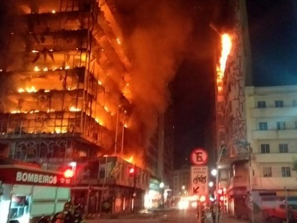 In this photo released by Sao Paulo Fire Department, a building on fire is seen in Sao Paulo, Brazil, on Tuesday.