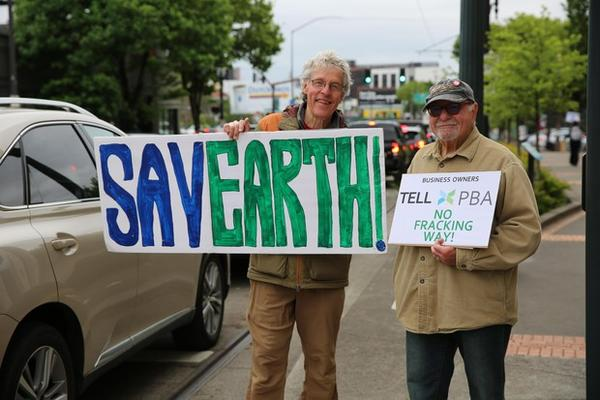 <p>Mark McLeod and Howard Shapiro with the Sierra Club and 350PDX protest the Portland Business Alliance's support for a proposed gas pipeline and terminal.</p>