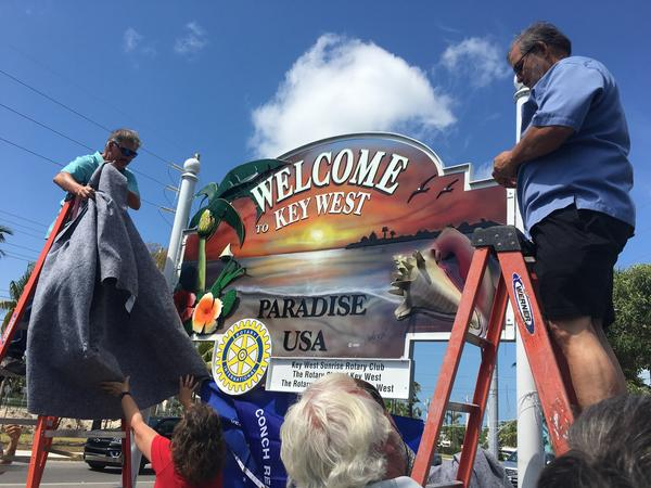 After being knocked down by Hurricane Irma, hijacked to the Gulf Coast, returned and refurbished, the Key West welcome sign was unveiled at the entrance to the island Tuesday.