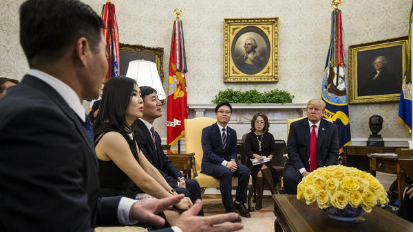 U.S. President Donald Trump meets with Hyeonseo Lee (far left) and other North Korean defectors in the Oval Office of the White House on Feb. 2, 2018.
