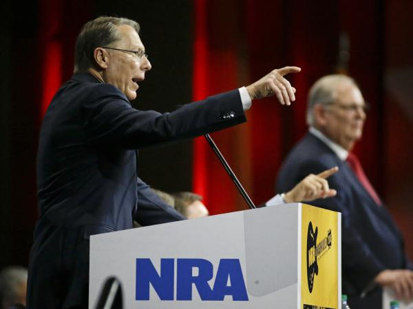 Wayne LaPierre, left, executive vice president of the National Rifle Association, speaks at the NRA convention in 2015. A Russian politician who claims to know President Trump through the group says he saw him at that convention.