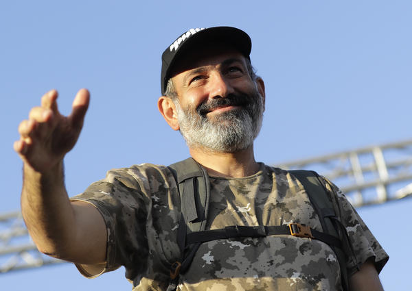Opposition lawmaker Nikol Pashinyan, clad in his trademark camouflage shirt and backpack, addresses supporters in Yerevan on Wednesday, just one day after the Republican Party derailed his bid for premier.