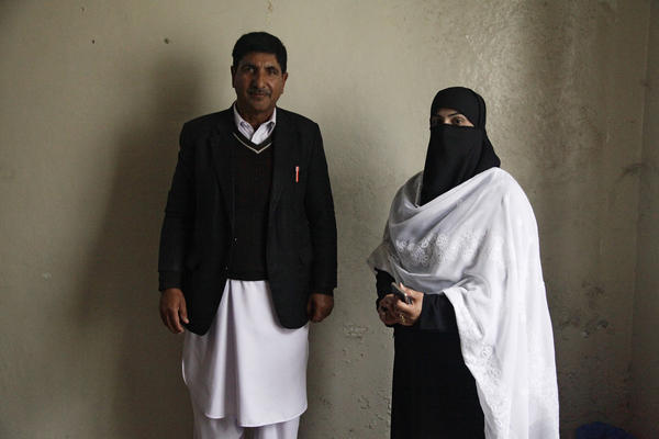Gohar Ali Khan (left), a senior lawyer, stands with his junior partner, Humaira Shaukat. She and other female lawyers began working here after the Taliban were pushed out by the Pakistani army in 2009. They defied the Taliban to study law.