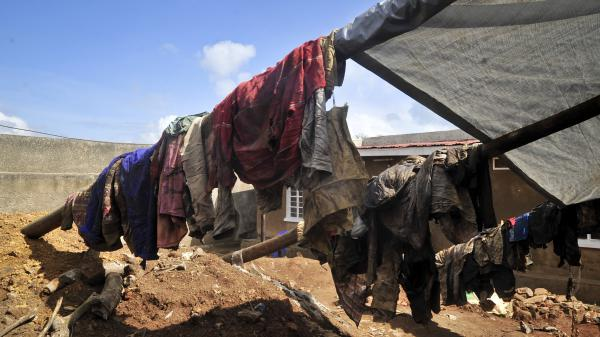 Clothes of genocide victims whose bodies were exhumed hang at the site of a recently-discovered mass grave near the capital Kigali, in Rwanda on Thursday, April 26, 2018.