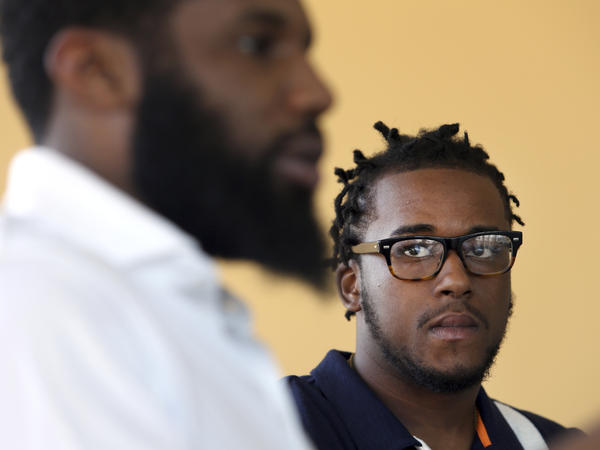 Rashon Nelson speaks as Donte Robinson looks on during an interview with the Associated Press last month in Philadelphia. Their arrests at a local Starbucks quickly became a viral video and galvanized people around the country who saw the incident as modern-day racism.
