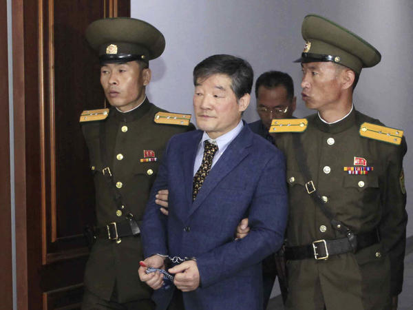 Kim Dong Chul (center) a U.S. citizen detained in North Korea, is escorted from a courtroom after his trial in Pyongyang, North Korea in April 2016. He is one of three Americans currently detained by the Pyongyang regime.