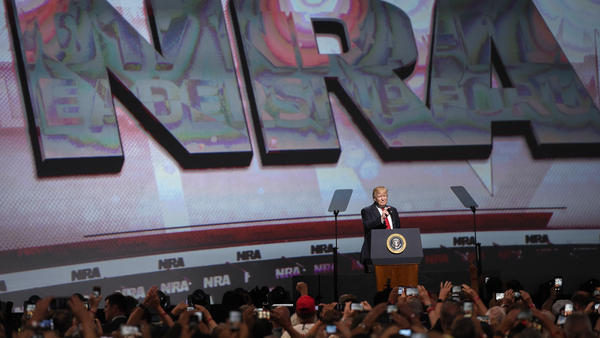 President Trump speaks to the National Rifle Association in 2017 in Atlanta. Despite new political pressure, the president and vice president are both scheduled to speak to the group this year.