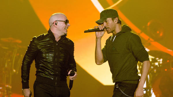 Pitbull and Enrique Iglesias perform outside of Miami in Rosemont, Illinois in 2015.